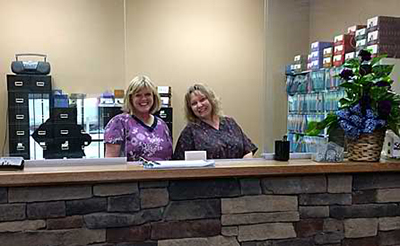 Peg and Julia at the Reception Desk